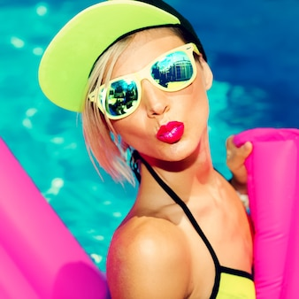 Glamorous bright fashion lady hot party in piscina