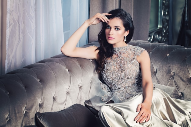 Glamour fashion model woman in celebrity interior