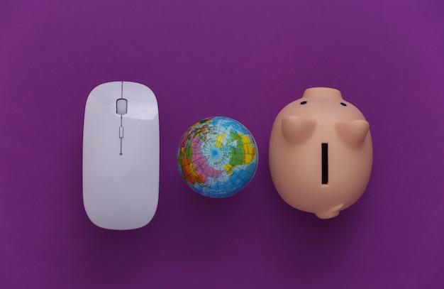 Rete globale. mouse e globo del pc, salvadanaio su sfondo viola. affari online, acquisti. vista dall'alto