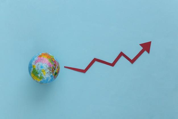 Globo con freccia di crescita che tende verso l'alto su un blu