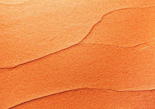Trama di sfondo rossetto arancione dorato lucido sbavato