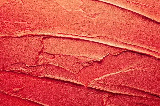 Trama di sfondo rossetto rosso lucido sbavato