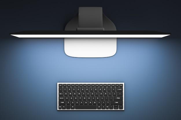 Monitor incandescente e tastiera del computer. vista dall'alto. argomenti di office.
