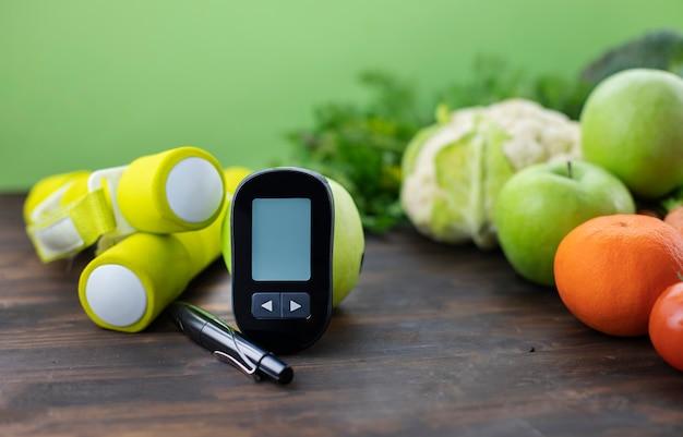 Misuratore di glucosio basso glicemico cibo sano e manubri dieta diabetica e concetto di vita sana