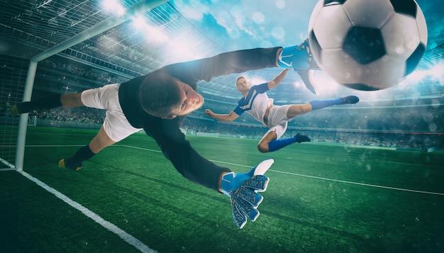 Il portiere prende la palla nello stadio durante una partita di calcio