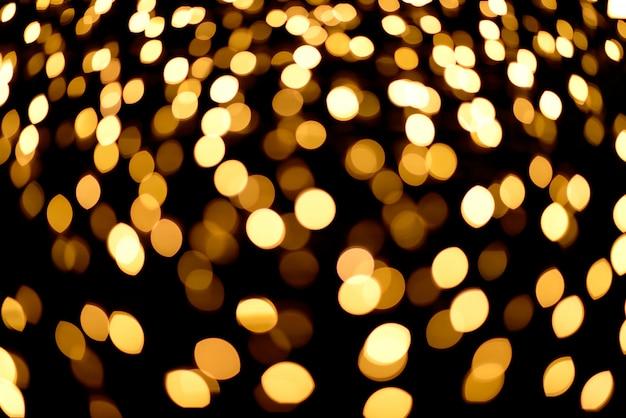 Fondo astratto del bokeh dell'oro luci di natale del bokeh di notte.