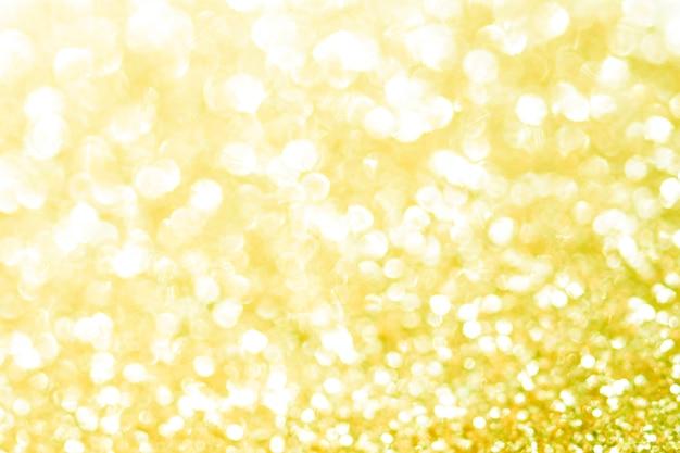 Trama di bokeh oro. priorità bassa festiva di scintillio con indicatori luminosi defocused