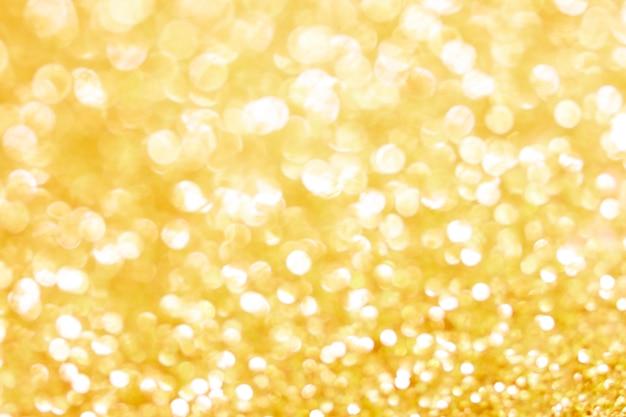 Trama di bokeh oro. priorità bassa festiva di scintillio con indicatori luminosi defocused.