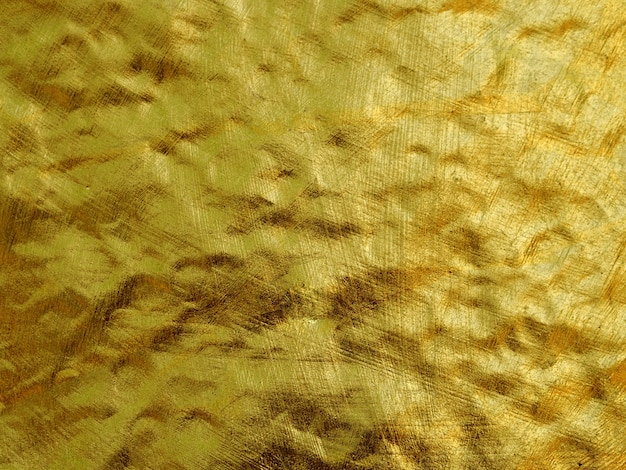 Sfondo astratto colorato di lamina d'oro.