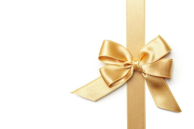 Fiocco regalo oro isolato su sfondo bianco