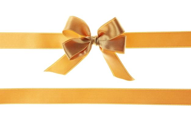 Fiocco regalo oro isolato su bianco
