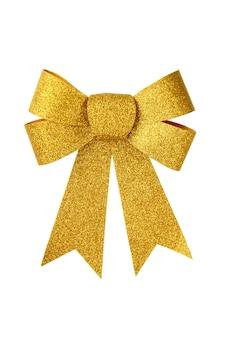 Nastro dell'arco del regalo dell'oro isolato su bianco.