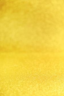 Sfondo glitter oro da vicino. sfondo sfocato giallo scintillante.
