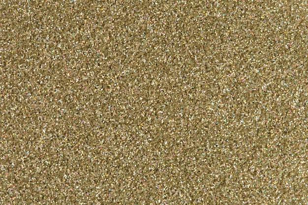 Trama glitter oro. immagine a basso contrasto. ciao foto ad alta risoluzione.