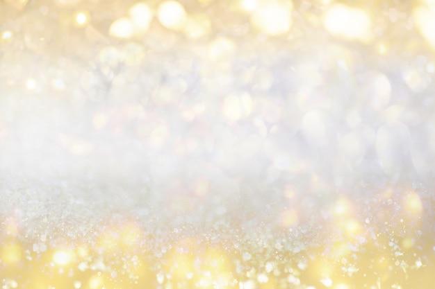 Luci dorate defocused di natale festivo della luce dell'oro