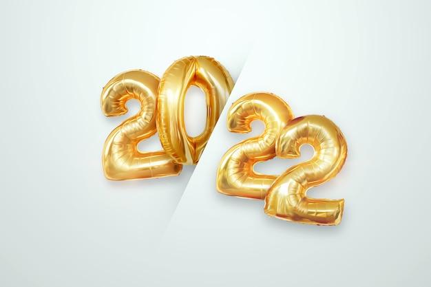 Numeri d'oro 2022 da palloncini in lamina d'oro. buon anno. design moderno su sfondo chiaro. modello di progettazione, intestazione per il sito, poster, biglietto di capodanno. illustrazione 3d, rendering 3d.