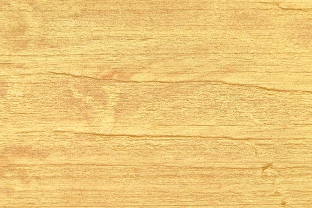 Vernice dorata su una superficie in legno. sfondo per il design