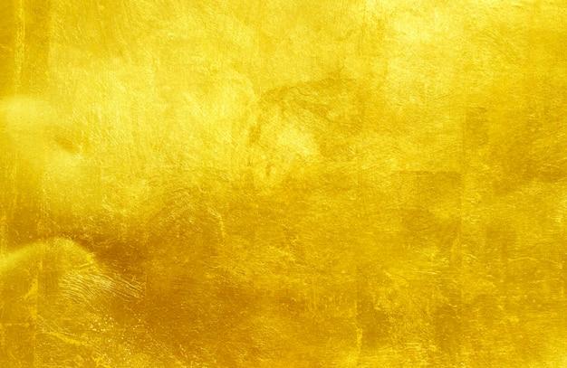 Fondo dell'estratto di struttura d'acciaio del metallo lucidato oro.
