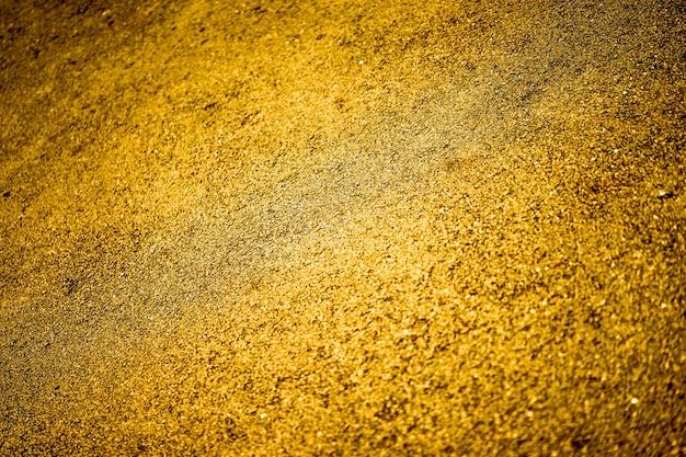 Fondo piatto di pietra d'oro.