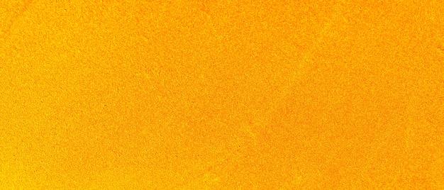 Parete astratta dorata. trama oro lucido di lusso. decorazione natalizia da parete. vuoto per il designer. minimalismo
