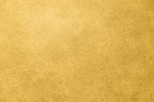 Trama di sfondo di carta vintage sfondo dorato sul muro