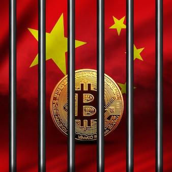 La moneta bitcoin dorata sulla bandiera cinese sullo sfondo del concetto di criptovaluta bitcoin è bloccata in una gabbia di ferro