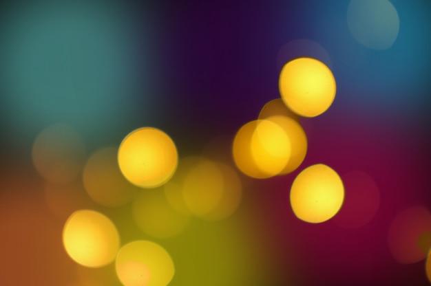 Luce dorata dell'estratto del bokeh, fondo arancio