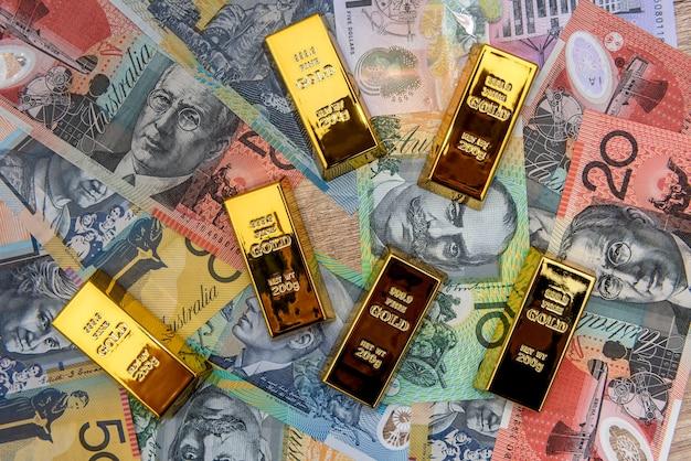 Lingotti d'oro alle banconote del dollaro australiano