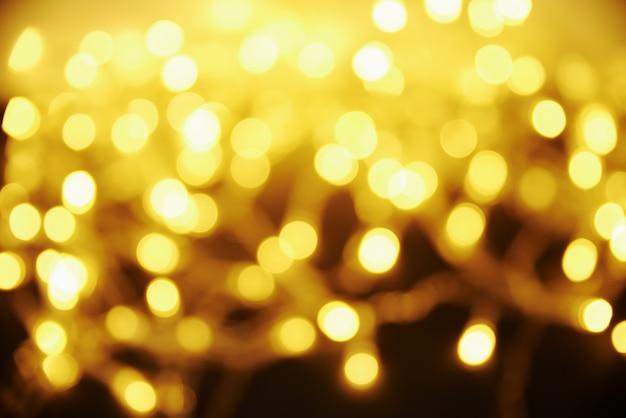 Sfondo sfocato color oro. sfondo astratto con bokeh.