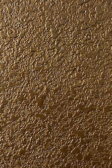 Muro di cemento dorato con luce soffusa proveniente da sinistra per il lavoro di progettazione illustrazione 3d