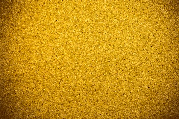 Fondo dorato di struttura di legno del sughero.