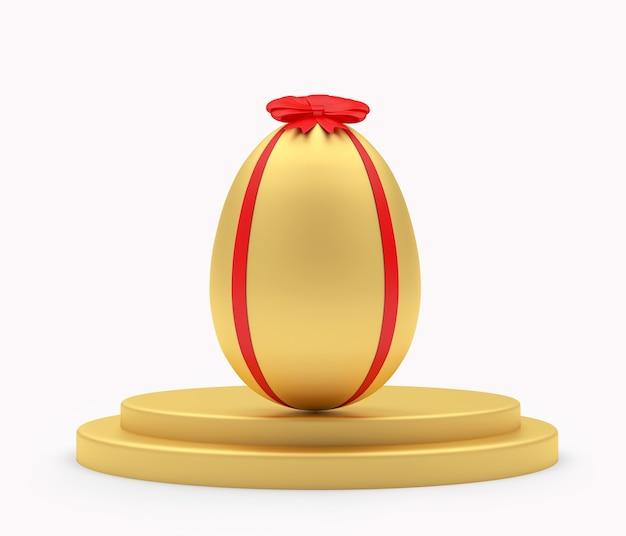 Uovo di pasqua dorato su un supporto