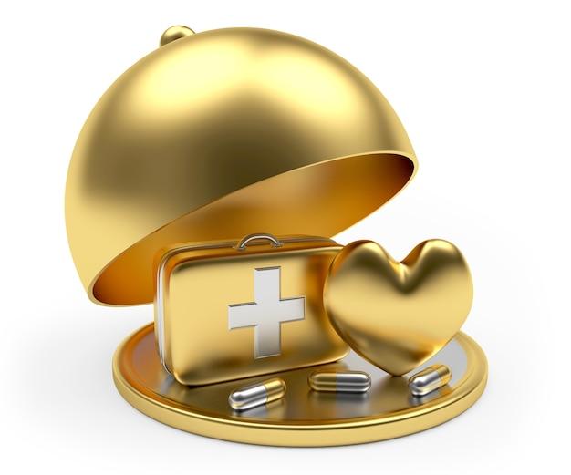 Kit di pronto soccorso dorato, cuore e pillole sul vassoio con coperchio aperto