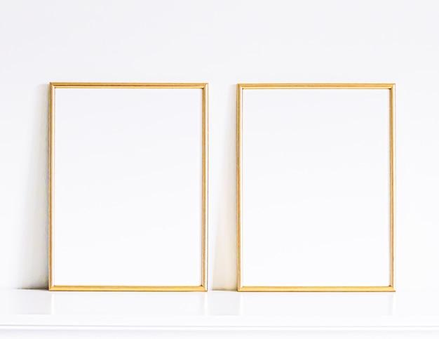 Cornice dorata su mobili bianchi, arredamento e design per la casa di lusso per la stampa di poster mockup e vetrina del negozio online di arte stampabile