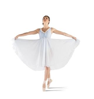 Graziosa ballerina in posa sulle punte con tutù