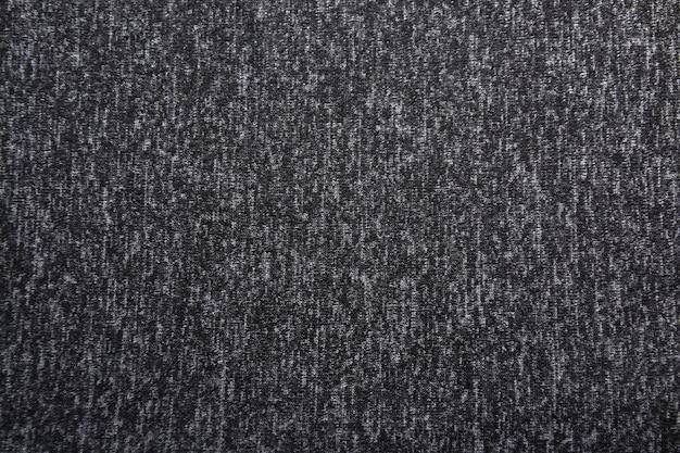 Sfondo grigio scuro sfumato con trama tessile.