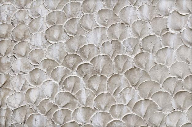 Priorità bassa o struttura del grunge della parete della vernice grigia del grano