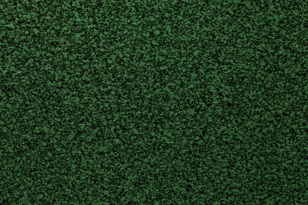 Sfondo liscio granuloso verde scuro del piano del tavolo. texture superficie astratta con piccolo motivo a briciole per l'interior design e il piano di lavoro della cucina.