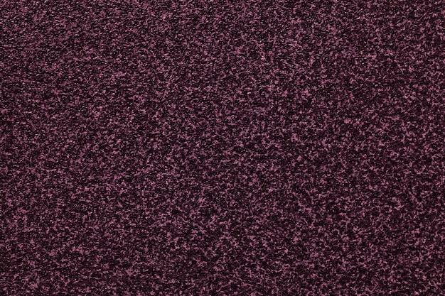 Sfondo viola scuro granuloso con motivo maculato.