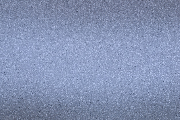 Lo sfondo in granito è blu chiaro con piccoli punti. oscuramento dall'alto e dal basso.