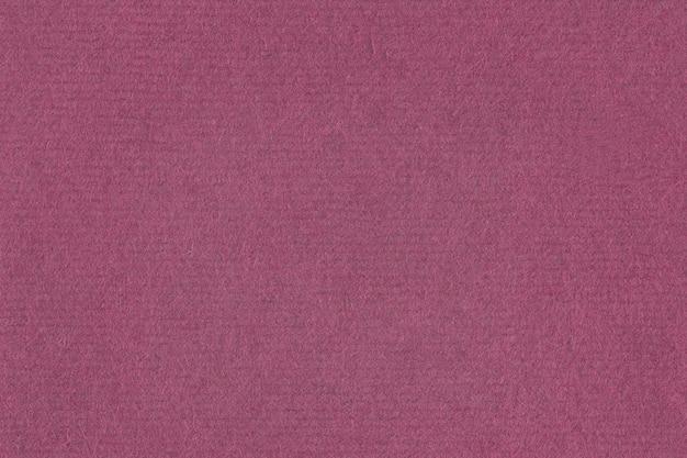 Fondo strutturato del tessuto viola dell'uva