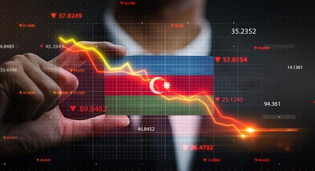 Grafico che cade davanti alla bandiera dell'azerbaigian. concetto di crisi