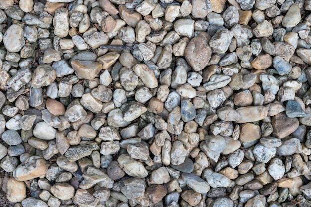 Fondo di struttura della superficie del fondale della ghiaia.