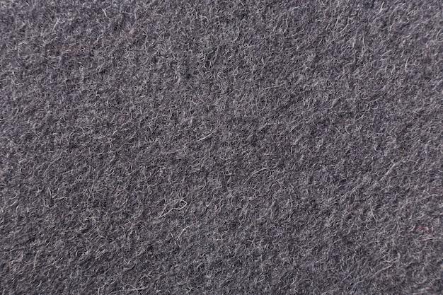 Sfondo grigio di lana infeltrita vista macro