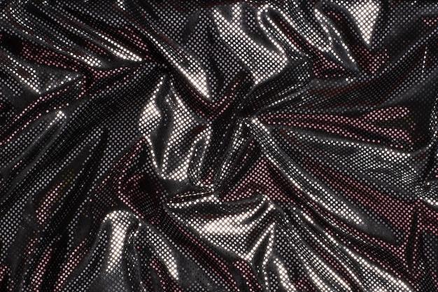 Priorità bassa di struttura del tessuto a pois argento metallizzato nero grigio