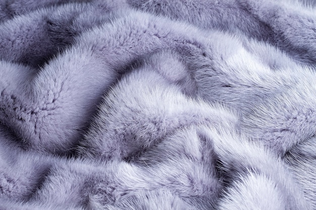 Sfondo grigio blu, consistenza pelliccia naturale, visone