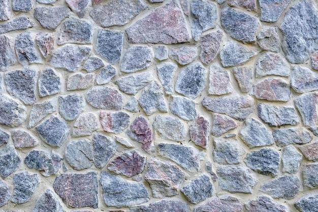 Struttura della parete di pietra grigia e blu, vecchio fondo del pavimento. pavimento in roccia naturale, motivo. superficie di mattoni