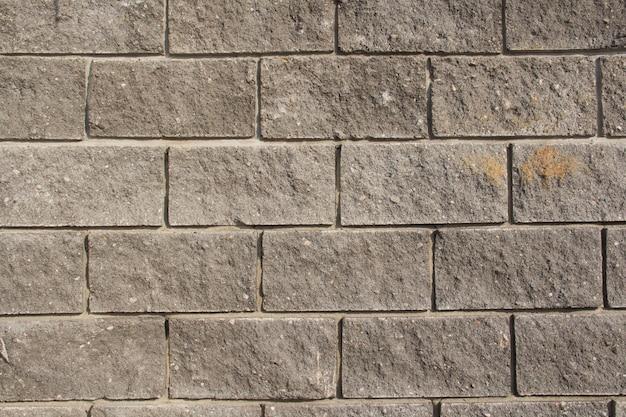 Mattone grigio primo piano grigio del muro di mattoni. la trama del primo piano del muro di mattoni. la trama del mattone