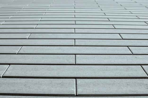 Muro di mattoni grigi in prospettiva