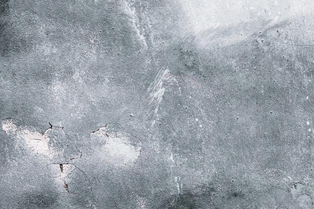 Muro di cemento grigio, fondo urbano grigio, struttura monocromatica di vecchio lerciume, carta da parati.